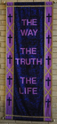 blue and purple banner with crosses border and words the way the truth the light